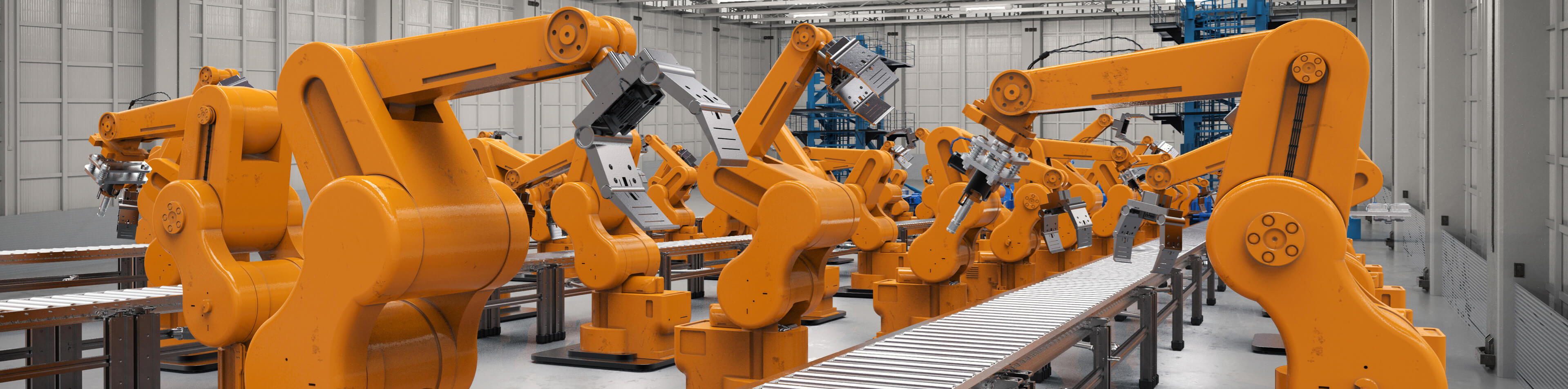 Assembly line with bright orange mechanical arms.
