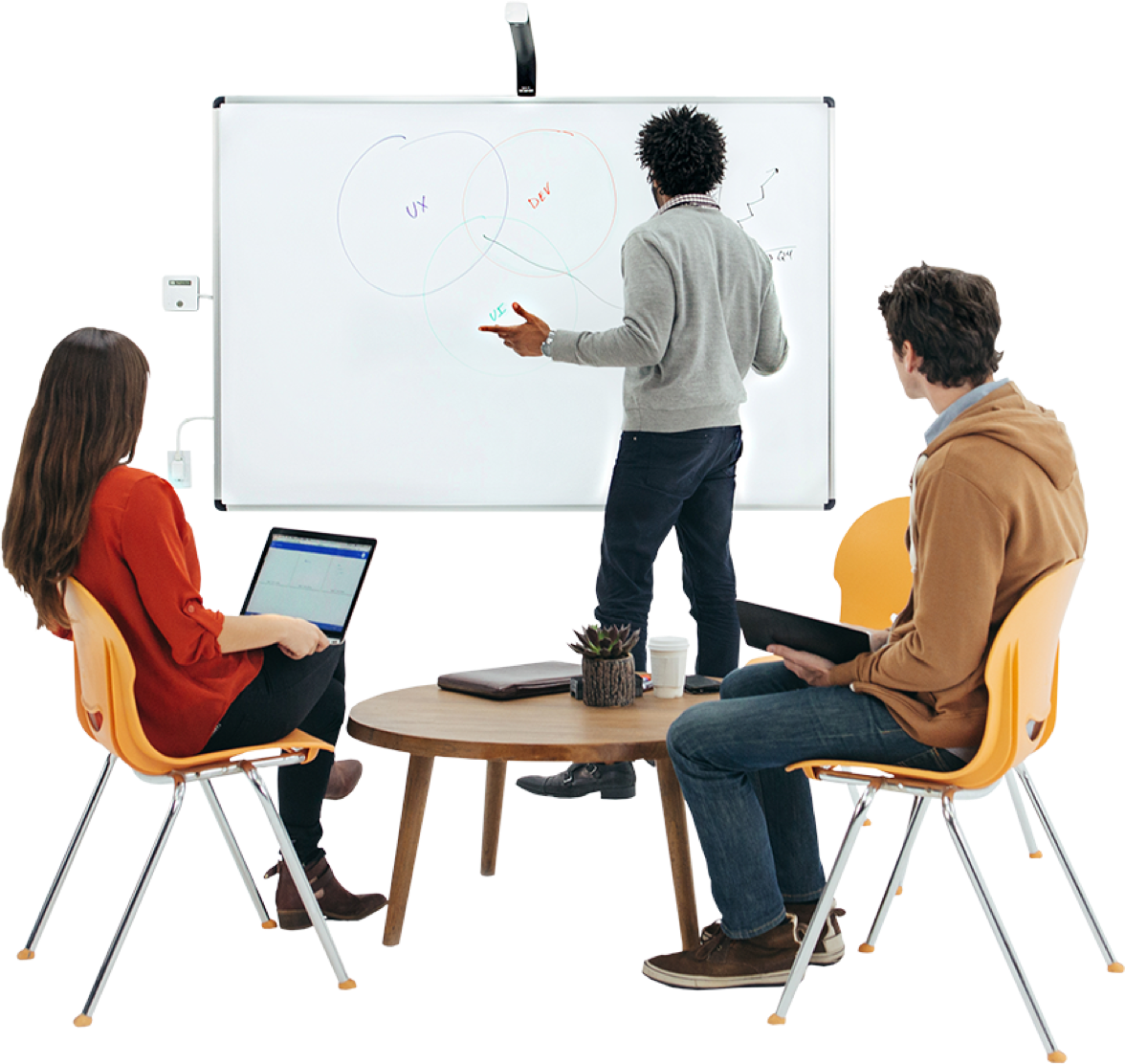 professionals meeting while utilizing a whiteboard and laptop.