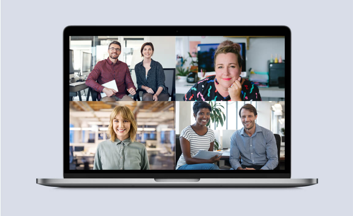 Professionals on video conferencing call with split screen.