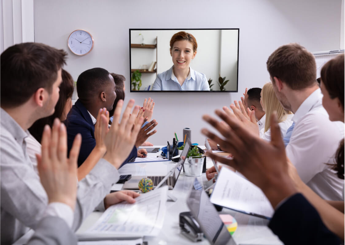 professionals clapping in video meeting after presenter comment.