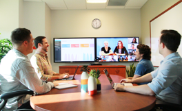 Lifesize Share being used by a remote team in a conference room.