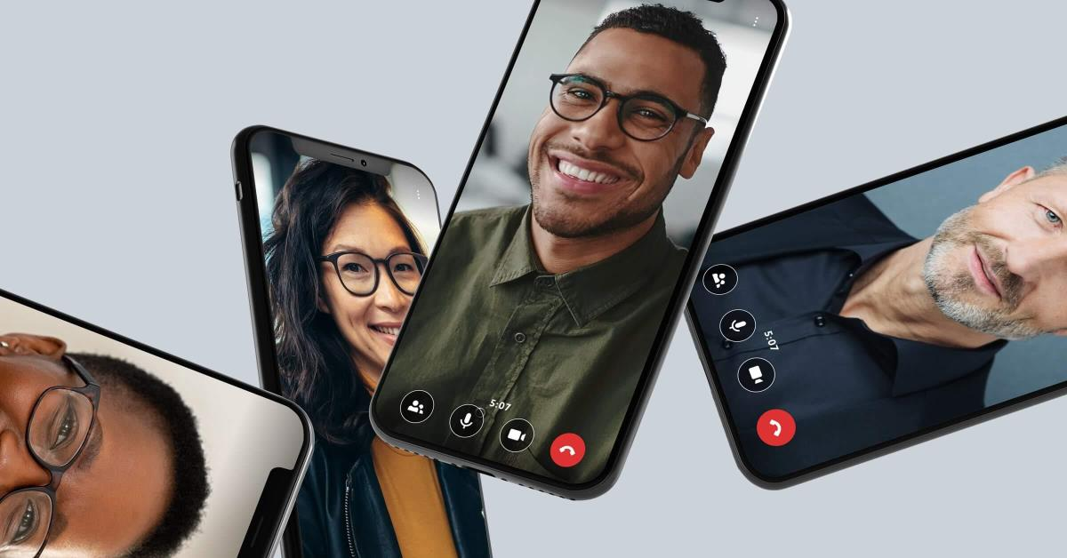 4 cell phones with people on a video call